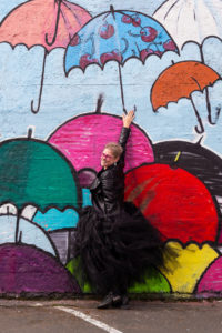Abby E. Murray in front of the umbrella mural