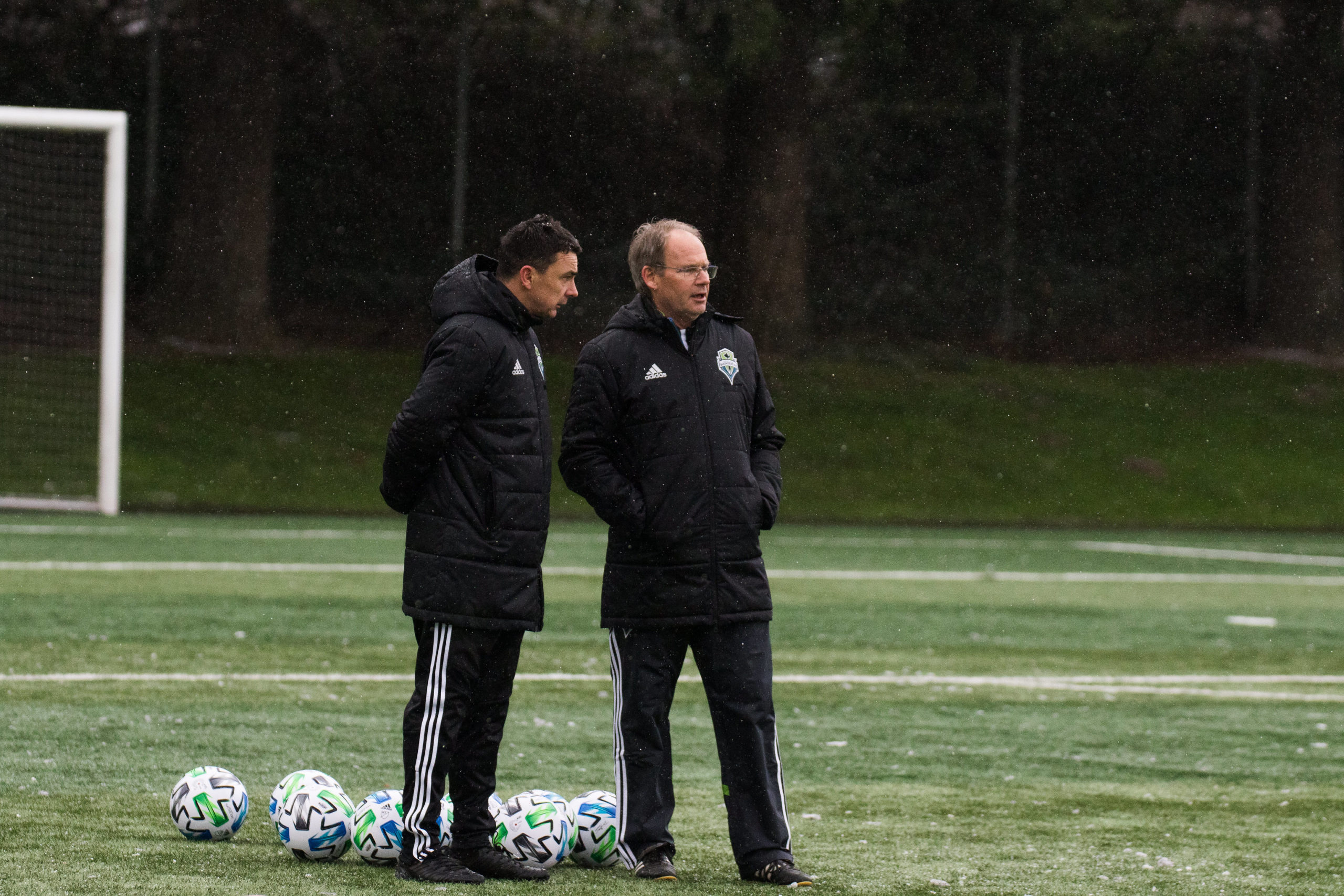 Tacoma Defiance coach Chris Little and Seattle Sounders head coach Brian Schmetzer survey their two squads during preseason