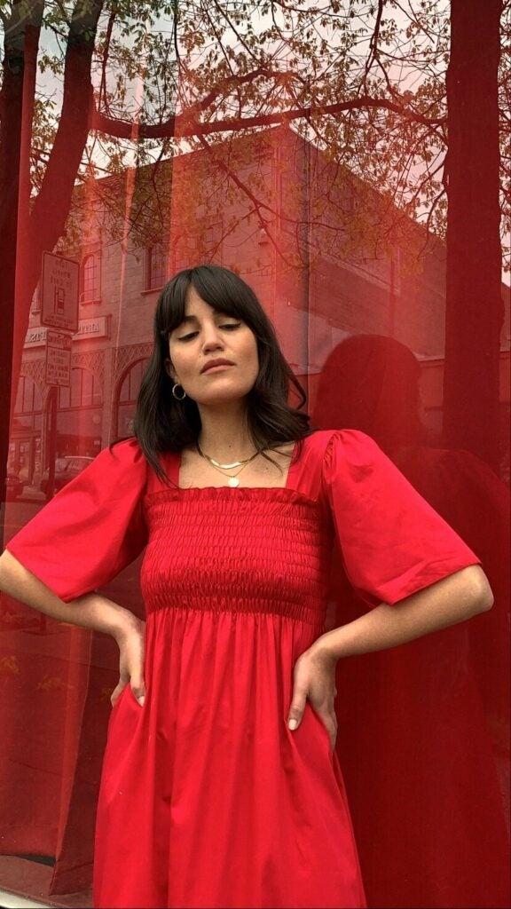 Cocobolo owner Lisa modeling a crimson Gah Toni Midi Dress