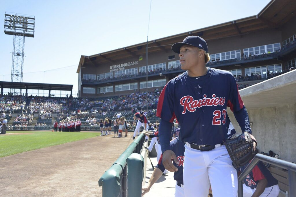 Taijuan Walker walking onto the field at Cheney Stadium