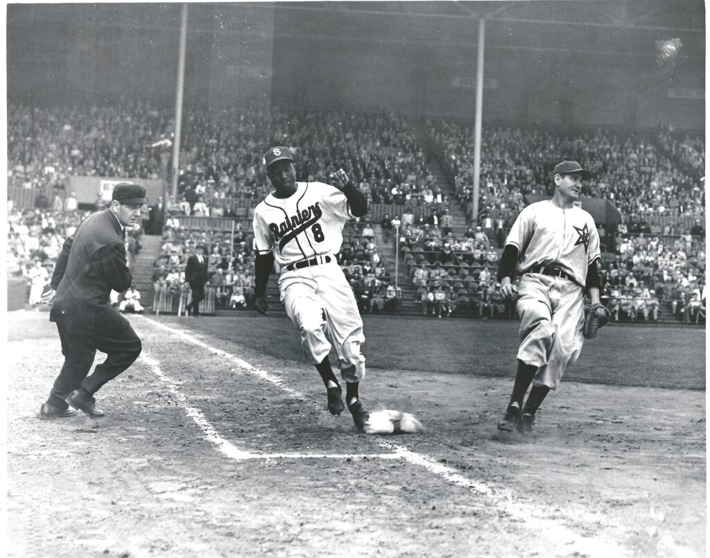 Black baseball history: Artie Wilson reaches first base safely for the Seattle Rainiers in a 1953 game at Sicks Stadium versus Hollywood